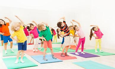 Happy kids doing side bending exercises