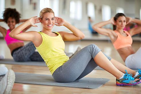Blond female in fitness group on trainin