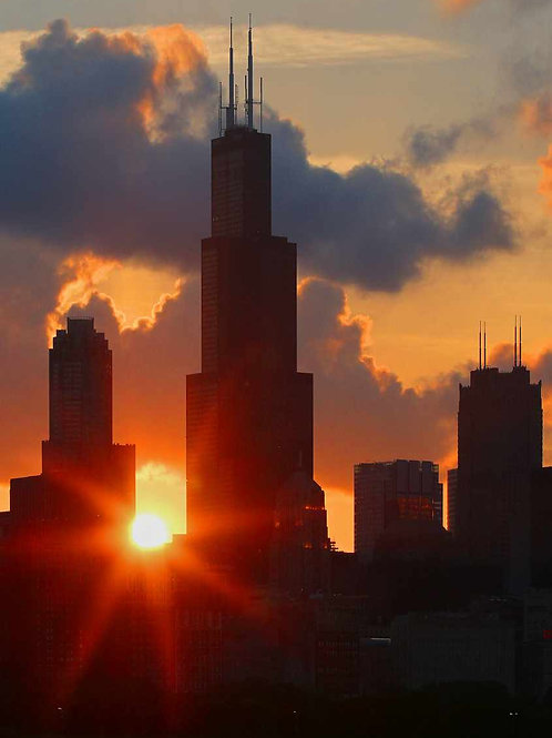Sun behind Willis Tower