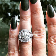 Almost 5 carats of total bling! If this baby fit my finger I would consider just keeping it! I would probably lose a finger over it.jpg