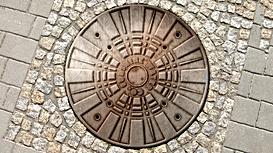Typographic Manhole Cover