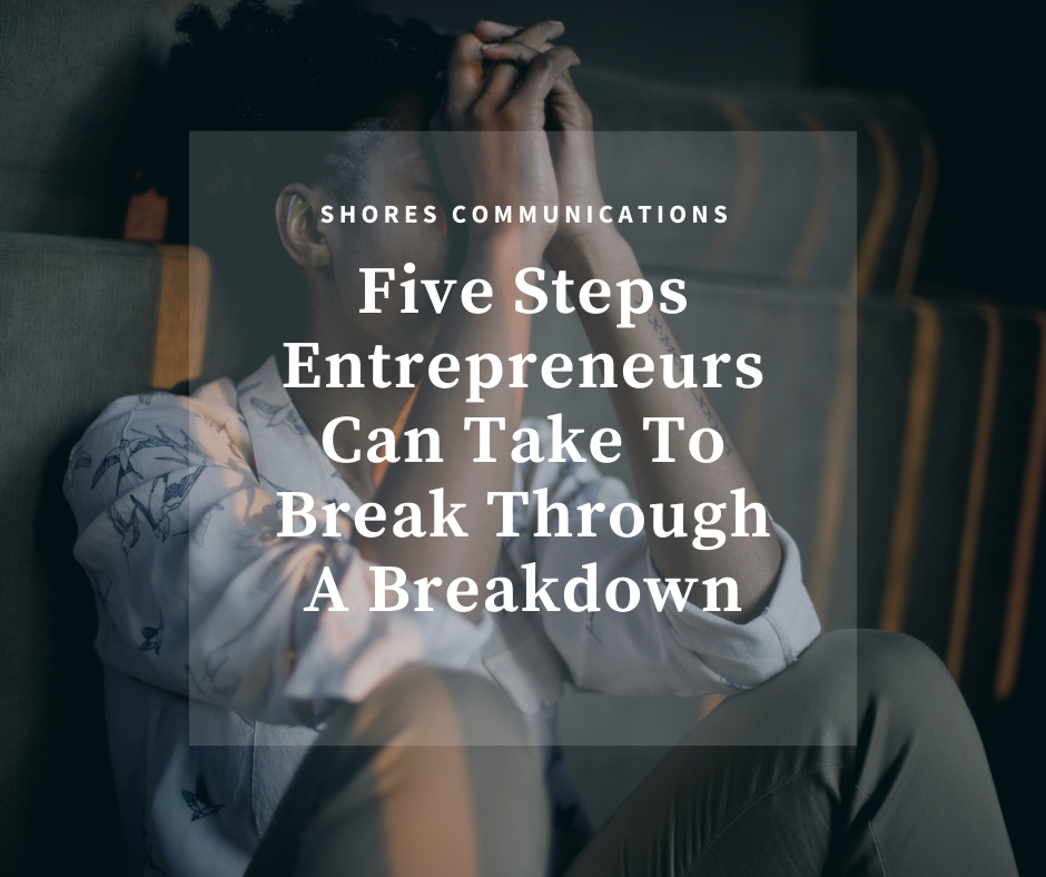 """A person sitting down with their hands clasped in front of their face in distress with overlay text that says, """"Five Steps Entrepreneurs Can Take to Break Through a Breakdown"""""""