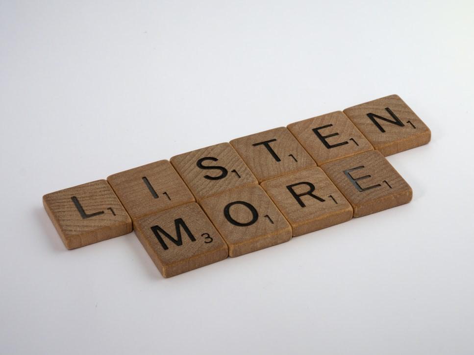 "Scrabble tiles that say, ""Listen more."""