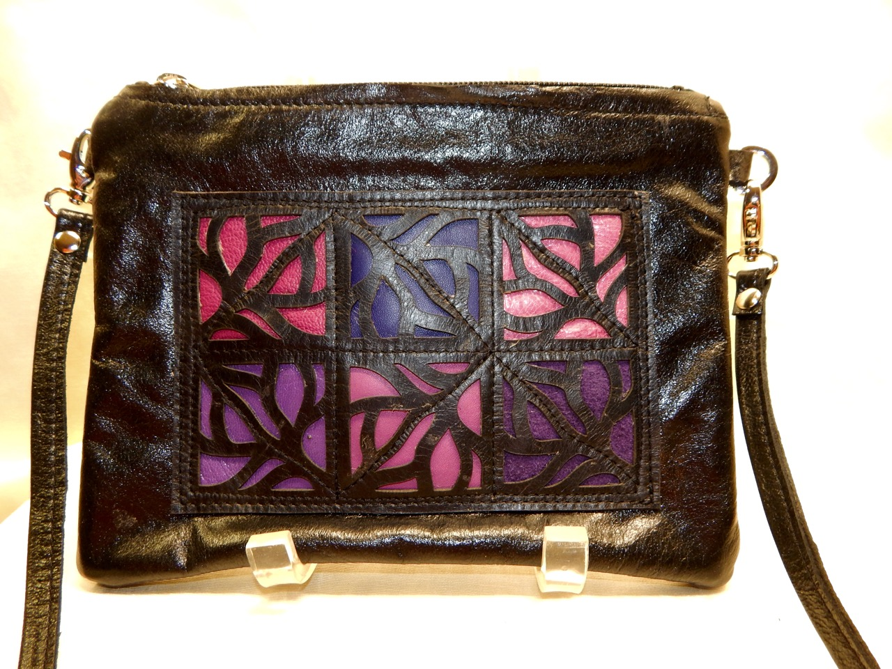 purple laser cut handbag