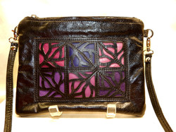 purple laser cut handbag