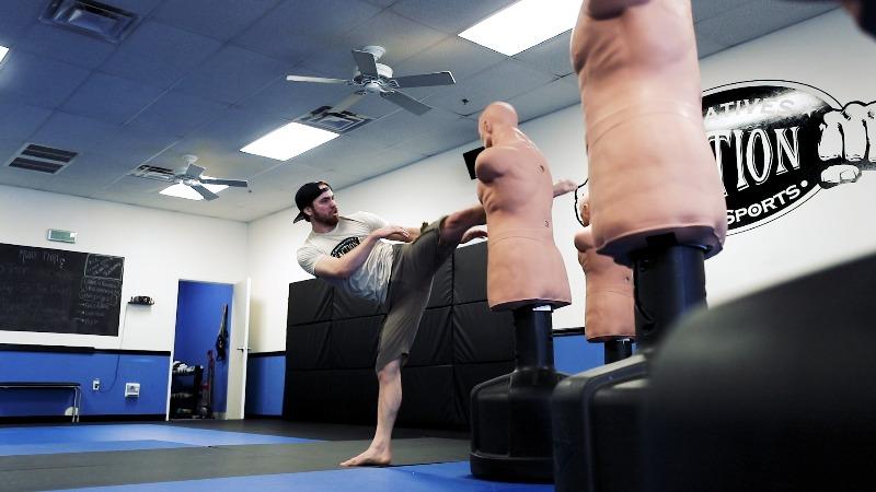 kicking target in kickboxing class