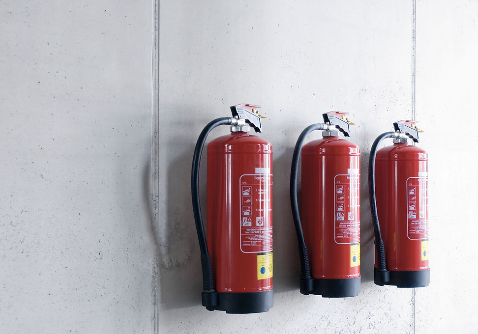 Three Extinguishers on wall