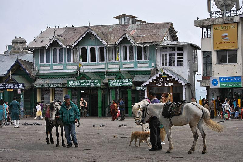 Old market area with horses and people wandering around