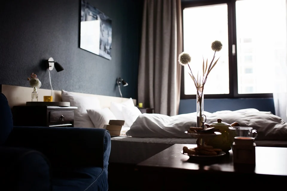 Hotel room with window and white bed with white pillows