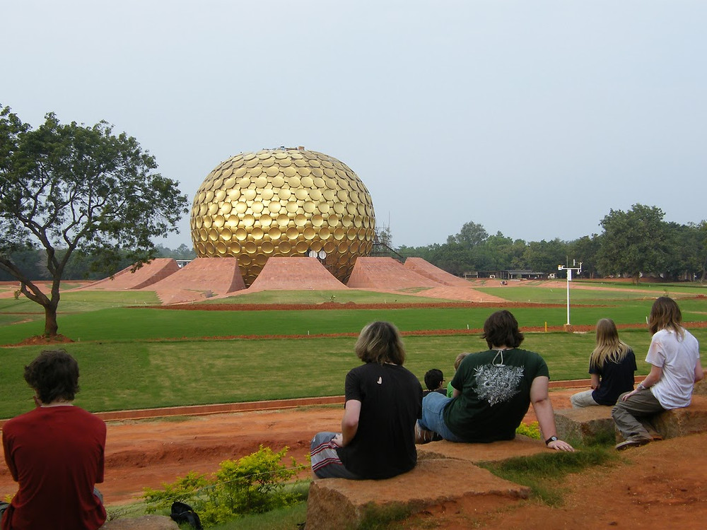 People sitting around a golden structure