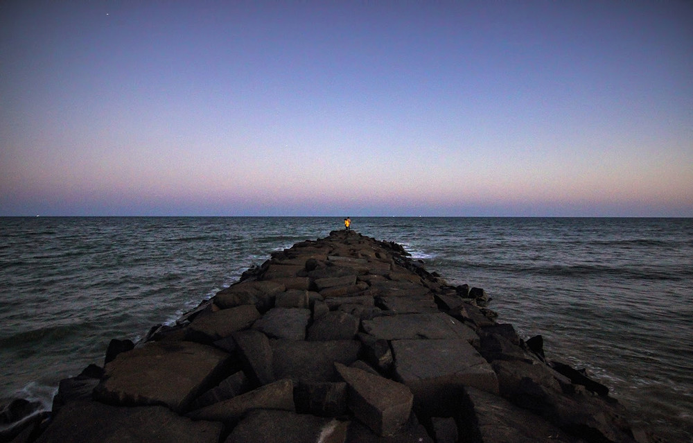 Rocky path to beach with sunset