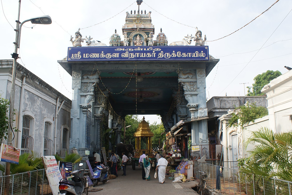 Temple entry way with people going in and out