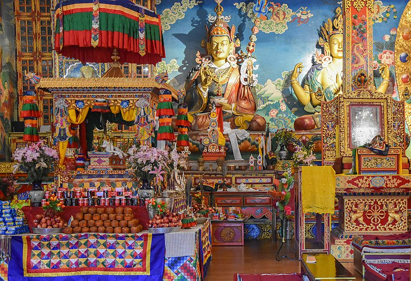 Colorful statues, flags, trinkets, and paintings in a shop