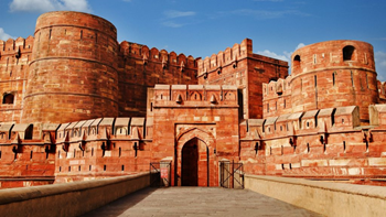 Red brick fort structure with carvings and old architecture