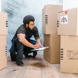 man_with_boxes_labelled_logo_slideshow