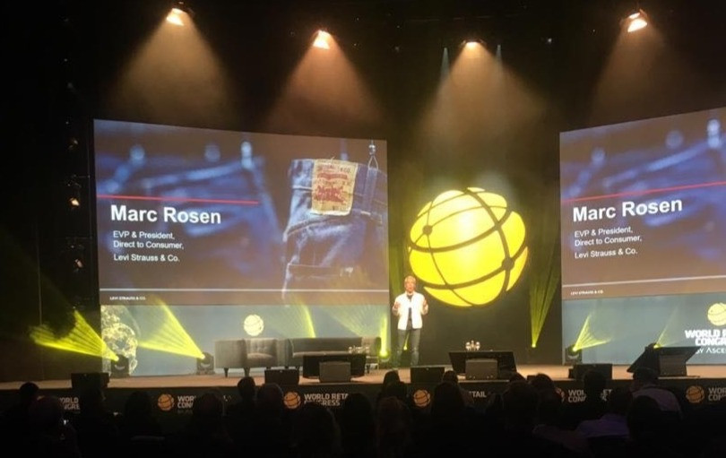 Marc Rosen speaking on stage at WRC
