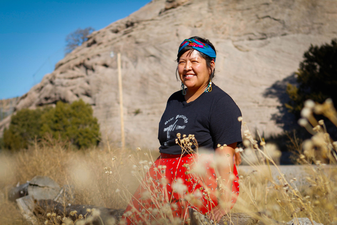 """Becki Jones poses for a photo at the Changing Women doula training in Window Rock, Arizona, on Thursday, Oct. 24, 2019.  She is a program manager at Planned Parenthood and a sex educator who participated in the training. """"It's building a revolution for us and I think we're taking back and reclaiming our knowledge and our sovereignty and our autonomy as indigenous peoples,"""" Jones said. She plans on bringing her knowledge from the training back into her work. (Photo by Delia Johnson/Cronkite News)"""