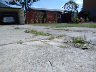 Garaże, widok na suszarnię i parking rowerów