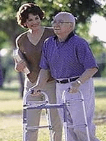 Man with walker walking with a woman.