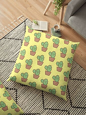 yellow pillow with a sleeping cactus design
