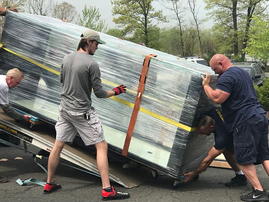 900 gallon tank being delivered.jpg
