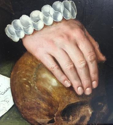 Detail of hand on skull