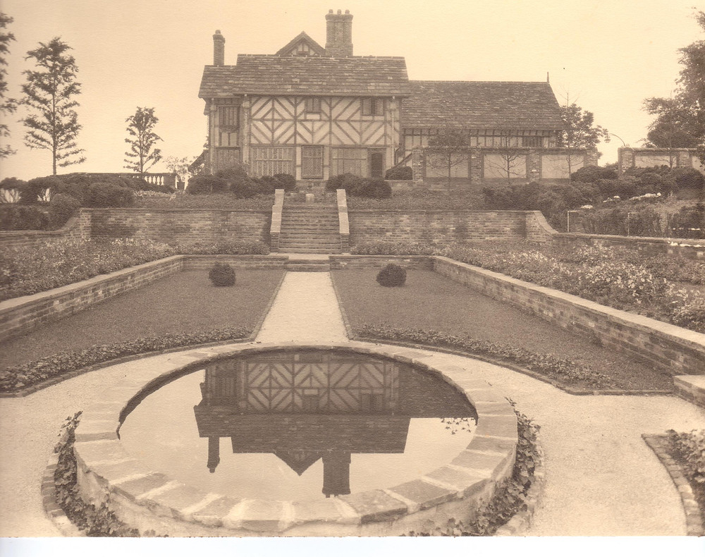 Historic photograph of Agecroft with gardens and small pond.