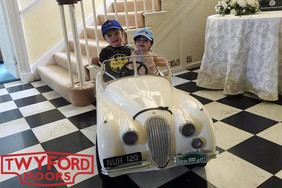 The youngest Twyford Moors team members celebrating E-type 60 in style.