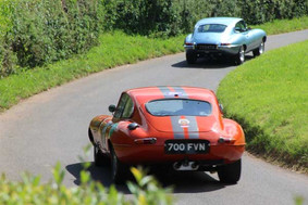 Cavalcade of E-types roaring up the Hill.
