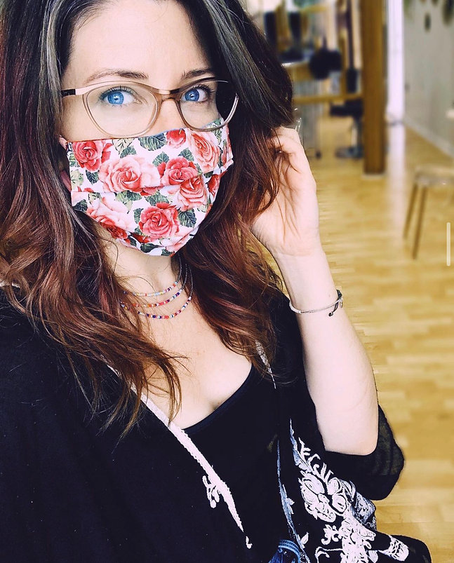 Katie Burns, hair stylist, at the salon wearing a mask