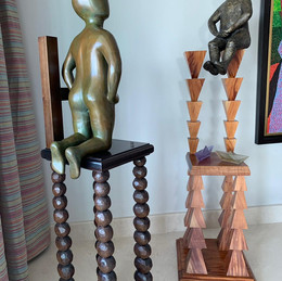 Left Sculpture  Material: Bronze and Wood Dimensions:  40 cm x 40 cm x 168 cm Right Sculpture Material: Bronze,Wood and Glass Dimensions: 40 cm x 40 cm x 185 cm