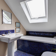 Bathroom created from under eaves space.