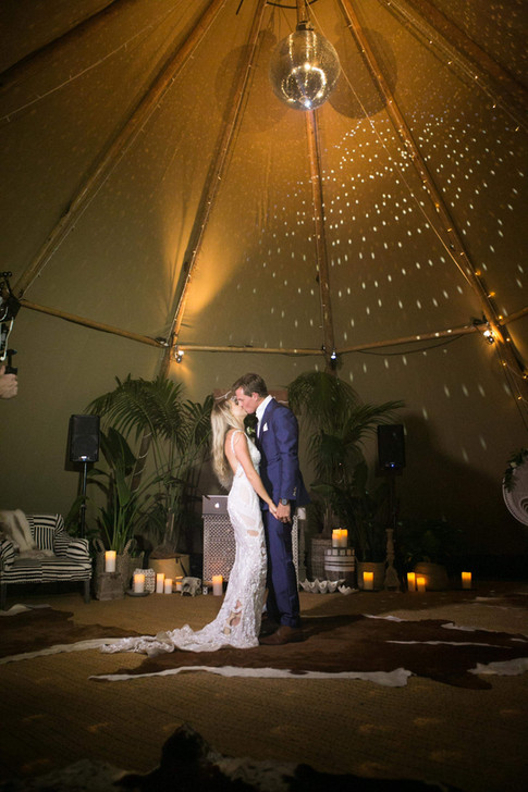 Couple under Giant Tipi and Disco Ball