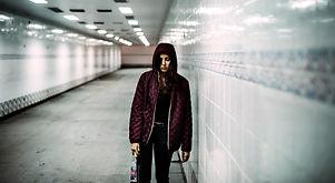 homeless-alcoholism-woman-holding-liquor