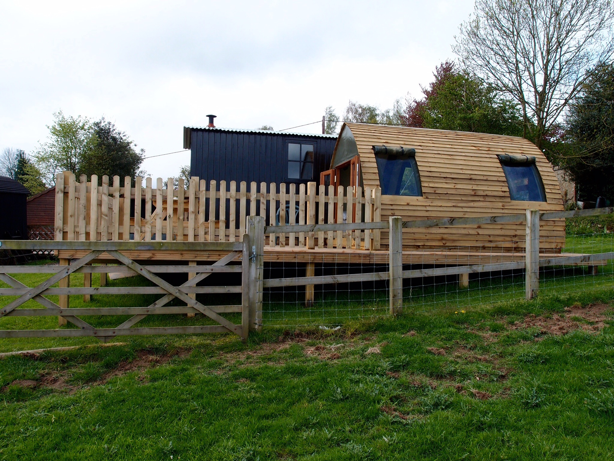 The Arc, decking and the Hut behind