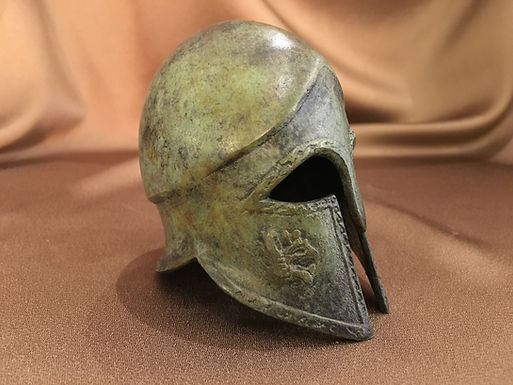 small bronze helmet with griffins