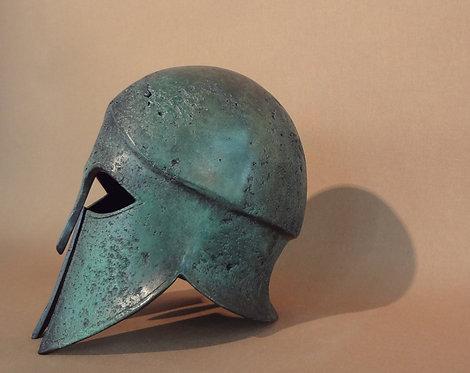 small bronze freestanding helmet