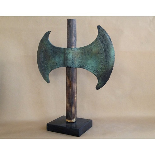 giant bronze labrys double-axe on a marble base