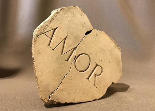 Latin inscription: 'Love'