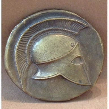 bronze shield and helmet coin paperweight
