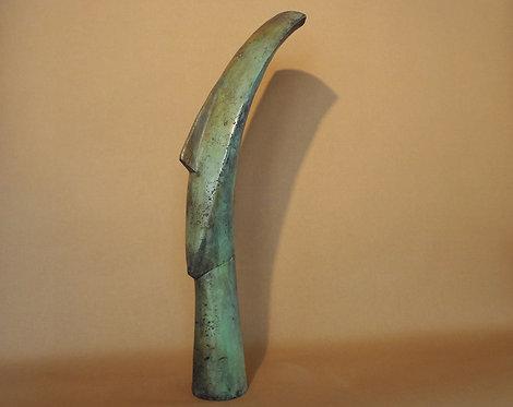 slim freestanding bronze Cycladic head
