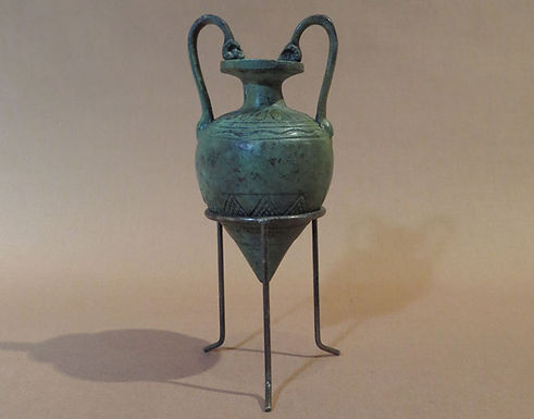 small bronze pointed amphora with ram head motifs