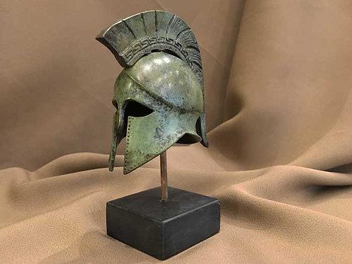 small bronze helmet with Greek key crest
