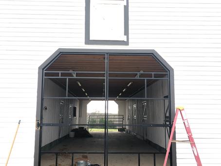 Custom steel barn door frames and hinges, ready for wood or sheet metal.
