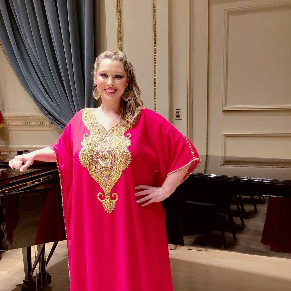 Jennifer standing in front of a piano on the Weill Recital Hall stage at Carnegie Hall. June 2019.