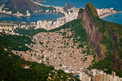 Aerial view of Favela da Rocinha, Biggest Slum in Brazil on the Mountain in Rio de Janeiro, and Skyl