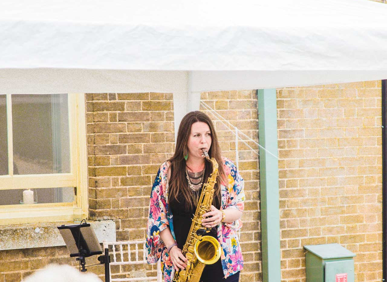 Caron Robinson play sax at Holkham Hall