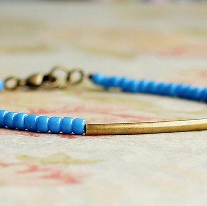 "7"" Cornflower Blue Seed Beads And Bronze Bar Bracelet"