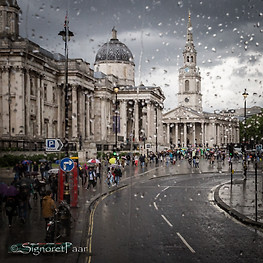 Rainy view from a double-decker bus