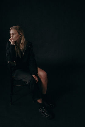 woman-in-black-sweatshirt-sitting-on-bla
